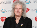 Brian May is interested in topping the bill if Adam Lambert can come along.