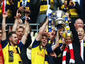 Arsenal lift the winners trophy following the FA Cup Final between Aston Villa and Arsenal at Wembley Stadium