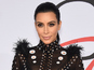 Kim Kardashian West's dress catches on fire
