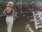 Watch Lily Allen burn 'F**k off Kanye' flag at Glastonbury Festival