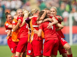 England's players celebrate Fara Williams' goal during extra time of their bronze medal match against Germany at the FIFA Women's World Cup