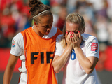 Laura Bassett of England is comforted by Jo Potter after the FIFA Women's World Cup Semi Final match