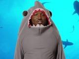 Hannibal Buress dresses as a shark on Conan