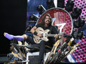 Foo Fighters frontman rocked out despite broken leg as band celebrate 20th anniversary of their debut album.