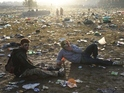 800 volunteers began cleaning up after festival-goers at 6am in return for free tickets.