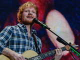 Ed Sheeran performs on stage at Wembley Stadium on July 10, 2015 in London, England
