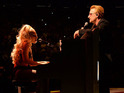 The popstar sang and played piano with the band at their sold-out show in the Big Apple.