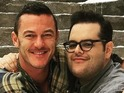 The LeFou actor marks the end of filming by posing with Luke Evans on set.