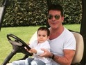 Cowell Junior delays auditions for a ride with his dad in a golf buggy.
