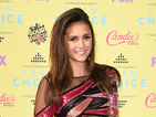 Nina pops in a pair of fake gnashers and talks about growing up with the audience at Teen Choice Awards.
