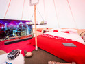 The supercharged pad includes a 65-inch 4K OLED Smart TV, Playstation 4 and smartphone projector.