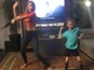 Taylor dances with young fan in cute video
