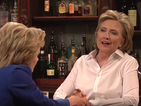 Hillary Clinton cameos in Saturday Night Live sketch - and mocks Donald Trump