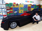 Holy hot wheels, Batman! This amazing recreation of the Batmobile was made with 500,000 Lego bricks